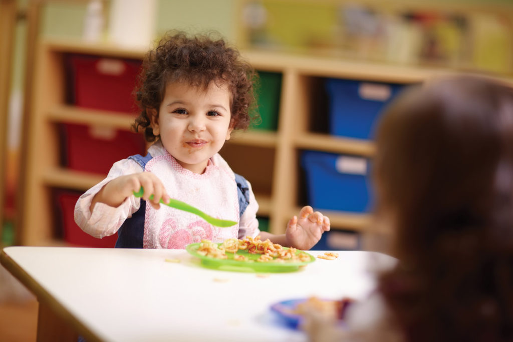 toddler eating at preschool