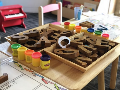 A pile of wooden block letters sitting on a table