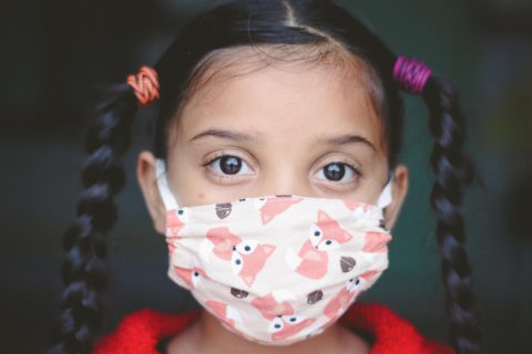Young girl wearing a mask
