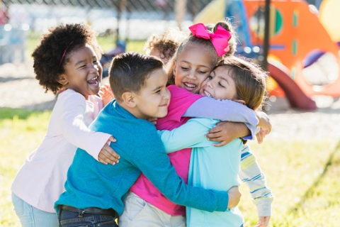 kids hugging on playground