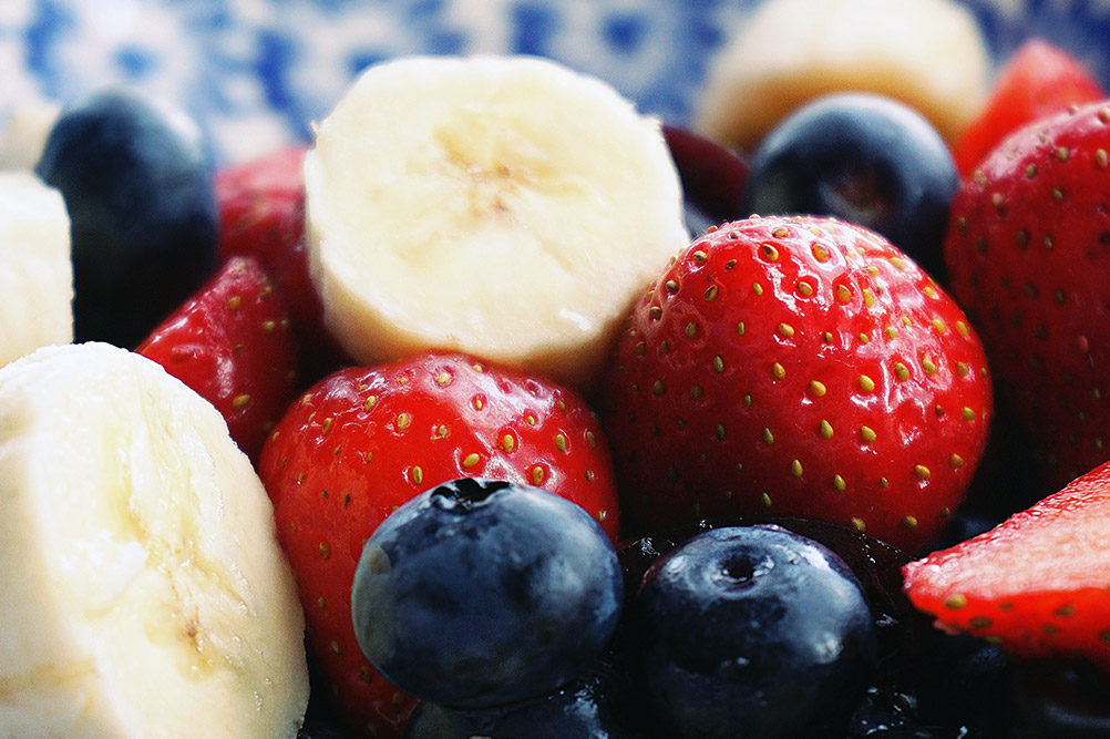 close up of strawberries bananas and blueberries